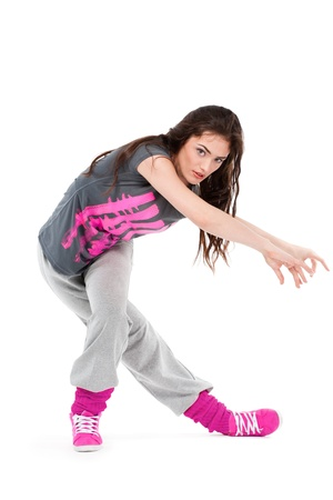 Hip-hop dancer girl posing making acrobatic movies photo