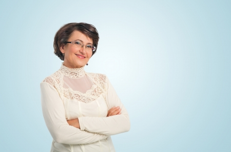 Portrait of success senior woman smiling while looking at you photo