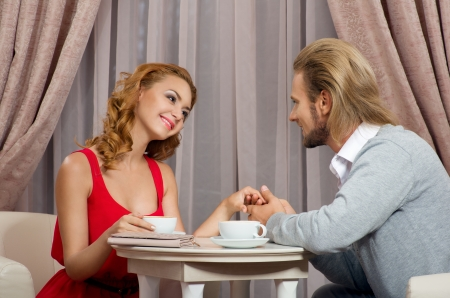 Portrait of a couple enjoying each other s company in a romantic dinner photo