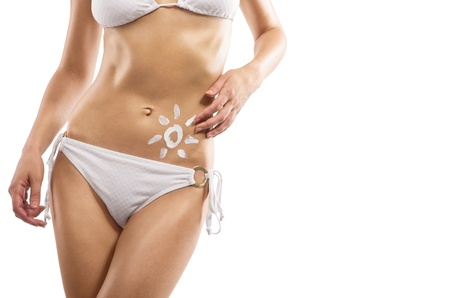 tanning: A sign of the sun on a female body, close-up, sea background Stock Photo