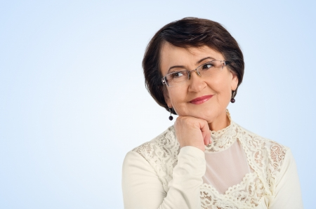 Portrait of success senior woman smiling while looking at you Stock Photo - 15681284