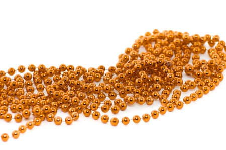 christmas beads: Background of gold  christmas beads isolated on white Stock Photo