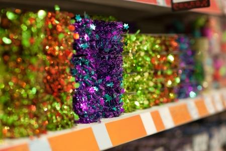frippery: Line of different xmas decor on shelfs in hypermarket