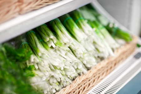 fresh green onion in box in supermarket photo