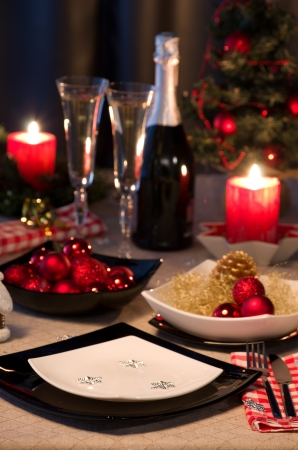 holiday dinner: dinner table decorated by new year ornament