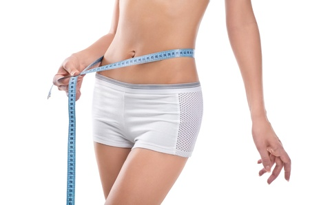 hands on waist: Woman measuring waist of perfect body by centimeter