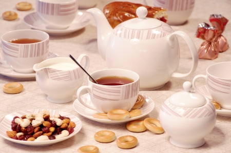 afternoon break: tea time with sweet cookies and nuts