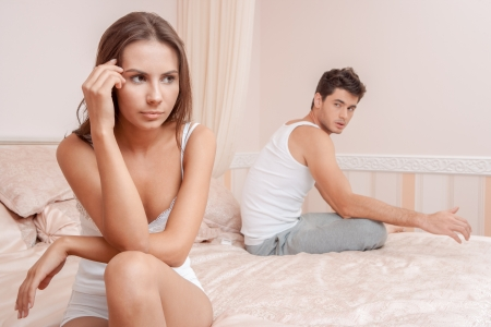 bored woman: Woman and man having a disagreement, Young couple in a bed bored woman Stock Photo