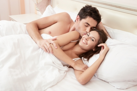 sensual couple: Young and happy adult couple in bedroom