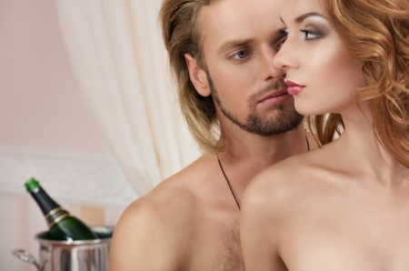 Young couple at the hotel, lovers, close-up faces photo