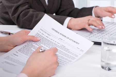 attorney: Hands of the woman signature document sitting on desk Stock Photo