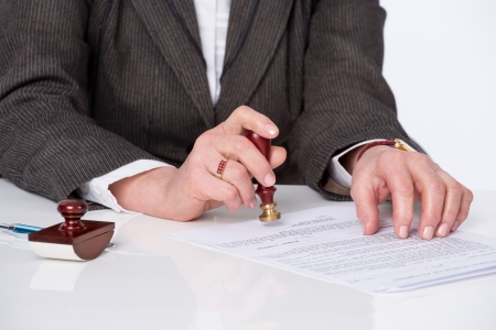signing authority: Businessman notarize testament at notary public office