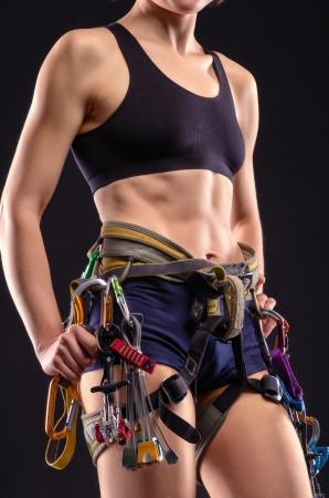 carabiner: beautiful female body in climbing equipment