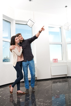 young pair, searching the real estate for a purchase