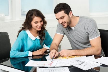 couple is considering the future design of the apartment photo