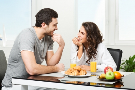 young beautiful couple having breakfast table
