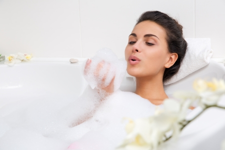sexy bath: beautiful young woman takes bubble bath