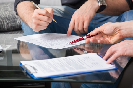 Hands of people signed the document, sitting at the desk photo