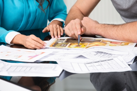 couple is considering the future design of the apartment, hands close-up Stock Photo