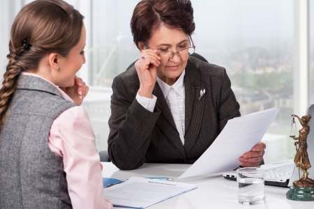 female lawyer: Lawyer or notary in the workplace advising a woman Stock Photo