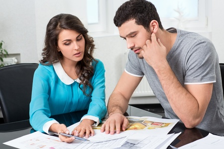 building planners: couple is considering the future design of the apartment