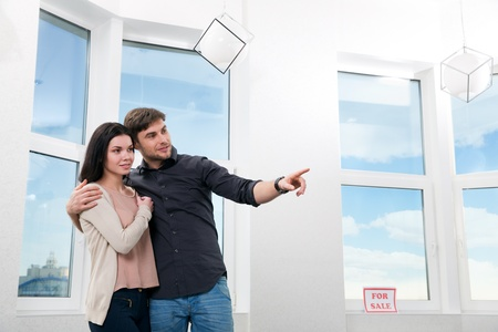 buyer: young couple, searching the real estate for a purchase Stock Photo