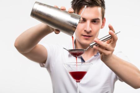 barman: bartender preparing coctail with bar equipment, studio shoot Stock Photo