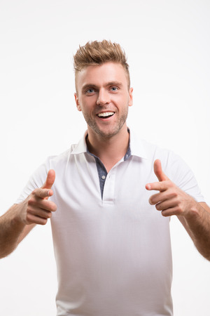 casuals: Young happy man with thumbs up sign in casuals