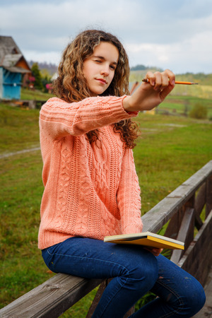 Young artist with pencil is ready to sketch photo