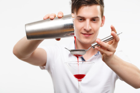 bartender preparing cocktail with bar equipment Stock Photo