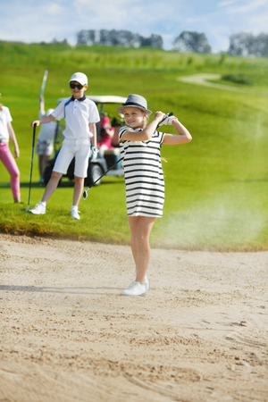 enjoing: Girl playing golf and  enjoing on the successful hit
