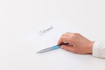 ot: Hands of elderly woman writing ot paper testament Stock Photo