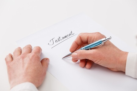 Hands of elderly woman writing ot paper testament Stock Photo