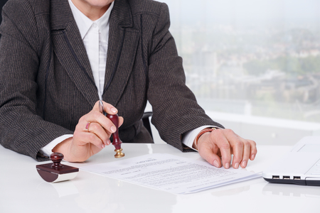 signing authority: Businesswoman notarize document at notary public office Stock Photo