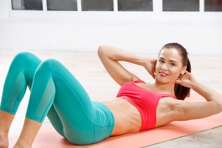 sport woman: Portrait of athletic young woman workout at fitness class in evening Stock Photo