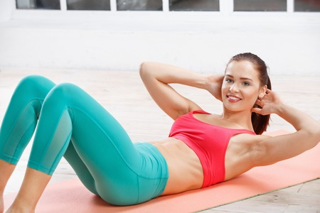 evening class: Portrait of athletic young woman workout at fitness class in evening Stock Photo
