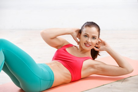female beauty: Portrait of athletic young woman workout at fitness class in evening Stock Photo
