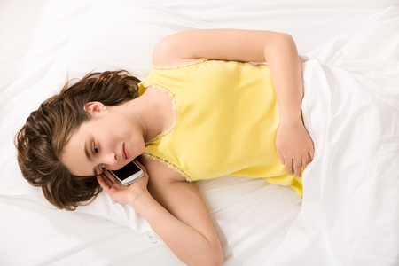 intimacy: girl became a woman concept -  young girl talking on phone about her intimacy secret Stock Photo