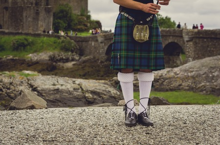 Bagpipers legs at traditional dress in Edinburgh, Scotland