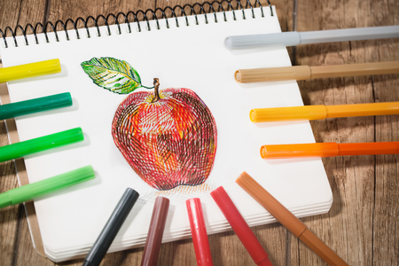 felt tip pen: Multicolored Felt Tip Pens with colour drawing at notebook