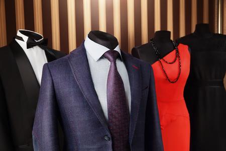dress suit: Half mannequin Men and Lady in elegant suit with dress