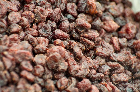 Date fruit closeup background. Date fruits on food store shelf on fruit market Stock Photo