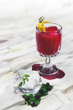 garnished cocktail on white background