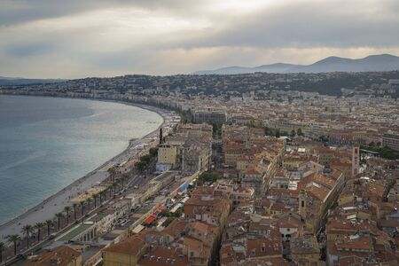 Luxury resort of French riviera. Beautiful view at city of Nice in France. Mediterranean sea, public beach, famous quay, palms and houses of Nice. Banco de Imagens