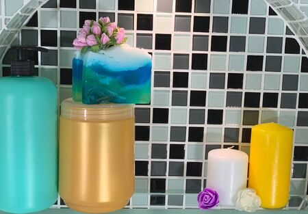 Jars with soap on the shelf. Hair shampoo and handmade soap on the shelf. Shelf in the bathroom.