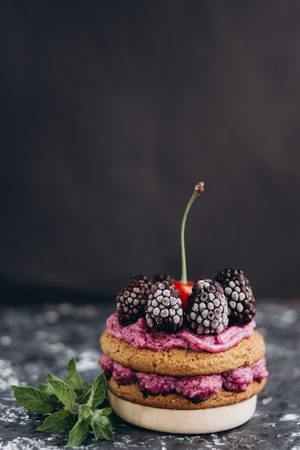 Delicious cookies with cream and fresh berries.
