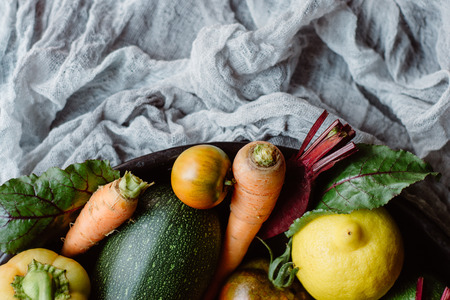 Mix of fresh fruits and vegetables on a plate. Ripe Vegetables Banco de Imagens