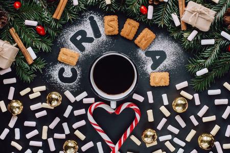 Cup of coffee on dark background. Winter flat lay Banco de Imagens