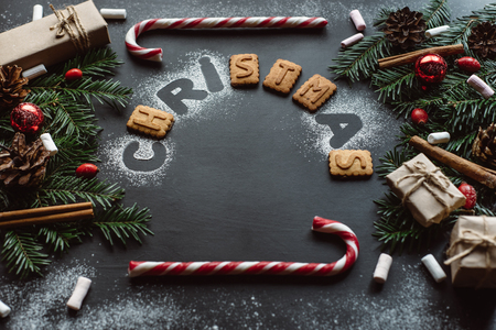 Christmas background with festive decoration on dark background. Winter flat lay