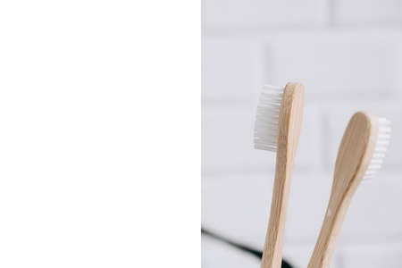Eco natural bamboo toothbrushes and frame on white background. Sustainable lifestyle and zero waste home. Dental care and Eco friendly and reuse concept. Copy space